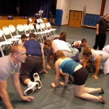 People crawling on stage hypnotized